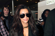 Reality star Kim Kardashian arrives on a flight at Charles De Gualle Airport on March 6, 2012 in Paris, France. After touching down, Kim wasted no time in heading to Hermes to do some shopping...