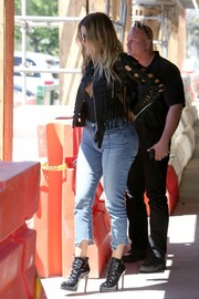 Khloe Kardashian added an extra dose of sexiness with a pair of lace-up stiletto boots by Alaia.