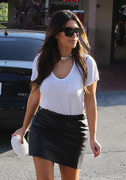 Kim's white pocket tee looked anything but basic when paired with a slick leather skirt.