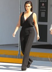 Kim Kardashian suited up a black onesie with a plunging neckline for a furniture-shopping trip in Miami.