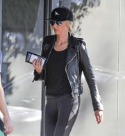 Kimberly Stewart headed out in Beverly Hills looking rocker-chic a black leather moto jacket.