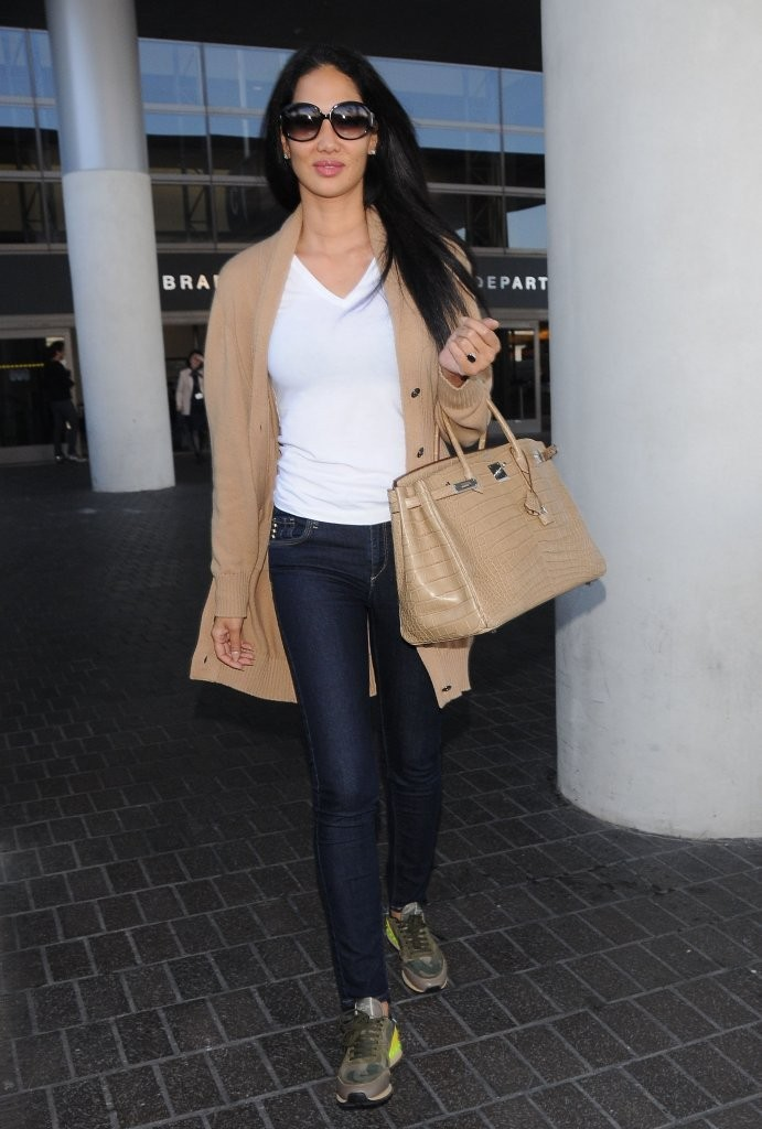 Model and fashion designer Kimora Lee arriving on a flight at LAX airport in Los Angeles, California on February 21, 2014.