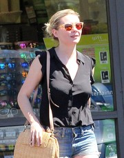 Kirsten Dunst donned a pair of yellow-rimmed wayfarers for a sunny day out in LA.