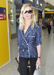 Kirsten Dunst was spotted in London looking effortlessly cool wearing her long bangs swept to the side.