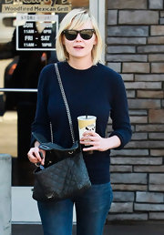 Kirsten Dunst is known for her hip indie style. Here the actress looks effortlessly chic in black Ray-Ban wayfarers.
