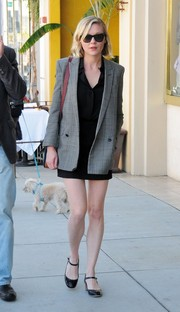 Kirsten Dunst was spotted out in Beverly Hills wearing a gray Glen plaid jacket over a super-short LBD.