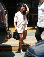 Kourtney Kardashian attended church wearing a cute pale-pink layered mini dress.