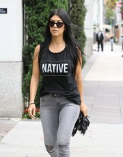 Kourtney Kardashian kept her eyes disguised behind a pair of Saint Laurent cateye sunnies while shopping in Beverly Hills.