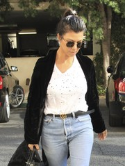Kourtney Kardashian styled her old jeans with a Gucci leather belt.