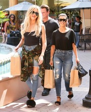 Khloe Kardashian paired her top with torn skinny jeans by Fashion Nova.