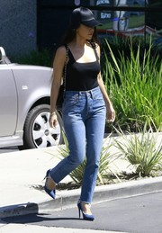 Kourtney Kardashian styled her casual look with blue pumps by Gianvito Rossi.