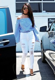 Kourtney Kardashian looked summery in a loose blue off-the-shoulder top by Finders Keepers while visiting a Los Angeles studio.