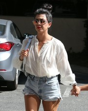 Kourtney Kardashian accessorized with modern round shades by Westward Leaning for a day out in Woodland Hills.