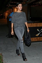 Kourtney Kardashian was casual and edgy in a gray sweatshirt and ripped jeans while out and about in Beverly Hills.