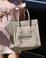 Kourtney Kardashian chose a sleek and sophisticated leather tote with double handles and a front zipper for her daytime carryall.