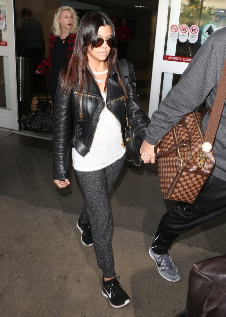 Kourtney Kardashian & Scott Disick Arriving On A Flight At LAX