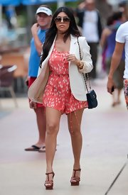 It didn't take Kourtney long to claim her petite figure again. She was spotted filming down in Miami wearing a cute jumper, tan heels and a quilted chain strap shoulder bag.