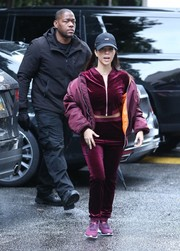 Kourtney Kardashian stayed comfy in a purple velvet track jacket by Naked Wardrobe while out and about.