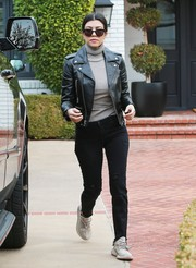Kourtney Kardashian teamed J Brand ripped jeans with a Saint Laurent leather jacket for an edgy daytime look.