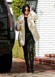 Kourtney Kardashian rocked round sunglasses to match her edgy outfit while walking through California.