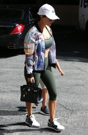 Kourtney Kardashian matched her bra with capri leggings, also by Under Armour.