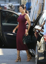 Kourtney Kardashian topped off her outfit with a dark green Celine Nano Boston bag.