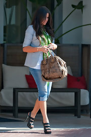 "Khloe is one of many celebs who love their ""Nightingale"" tote bags. She carries the worn brown leather version, which is neutral enough to be worn as an everyday bag."