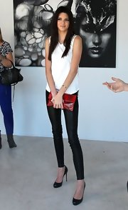 Kendall Jenner chose a pair of black leather pants to complement her white top while filming in Hollywood.