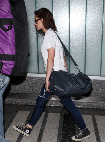 Kristen Stewart made her way through LAX carrying a black leather duffel bag by Gucci.