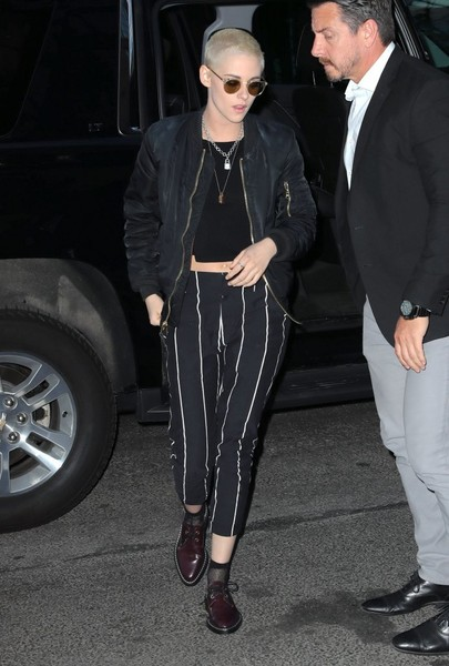 Kristen Stewart paired her shoes with sheer black socks.