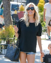 Kristin Cavallari could definitely turn heads even when dressed down in a loose tee and jean shorts!