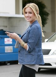 """The Hills"" star accessorized her look with a stack of gold bangles. They complemented her blonde hair and added a little sparkle to her denim ensemble."