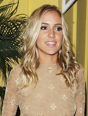 Kristin Cavallari wore her hair causally tousled while out and about in West Hollywood. To try her look at home, curl two-inch sections with a large-barreled curling iron, making sure to curl each piece in the same direction. Next, lightly comb through hair to soften curls and finish with a product like ALTERNA Caviar Anti-Aging Rapid Repair Spray for added shine.