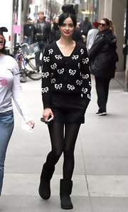 Krysten Ritter showed off her quirky style when she sported this black cardigan with a cute bow print.