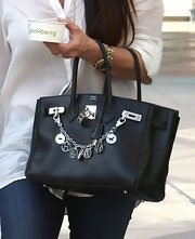 Kyle Richards sported this black tote with funky charms for an added edgy look.