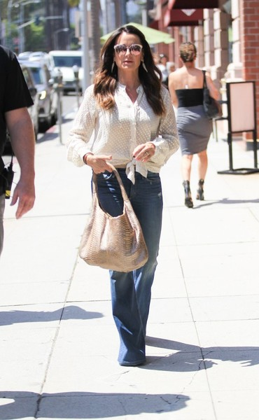 Kyle Richards took a walk in LA carrying a stylish snakeskin hobo bag.