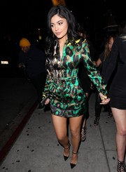 Kylie Jenner teamed her dress with black suede and PVC pumps by Gianvito Rossi.