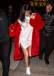 Underneath her eye-catching coat, Kylie Jenner was casual in a Calvin Klein sweatshirt.
