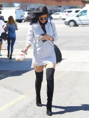 Black Brian Atwood thigh-high boots gave Kylie Jenner's outfit an ultra-sexy kick.