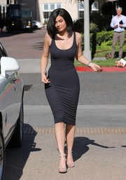 Kylie Jenner sealed off her head-turning look with strappy silver heels by Gianvito Rossi.