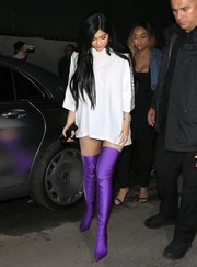 Kylie Jenner added a shock of color with a pair of purple thigh-high boots by Balenciaga.
