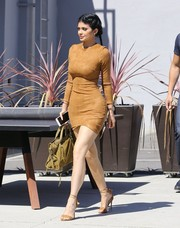 Kylie Jenner put her perfect figure on display in a tight tan suede dress by Mistress Rocks while visiting the Smashbox Studios.
