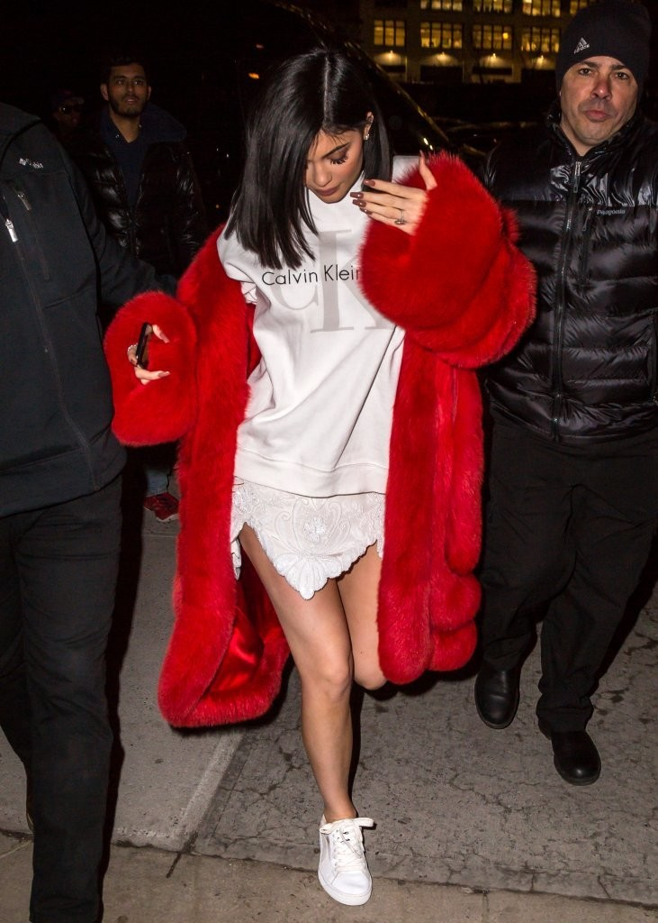 63ea53a0 Underneath her eye-catching coat, Kylie Jenner was casual in a Calvin Klein  sweatshirt