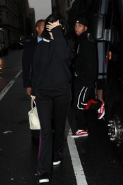 A pair of black sweatpants with red and blue side stripes completed Kylie Jenner's outfit.