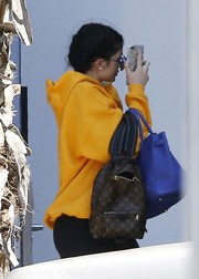 Kylie Jenner arrived on a flight from Turks and Caicos carrying a Louis Vuitton monogram backpack.