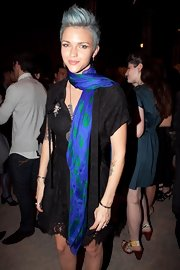 Ruby brightened her look with a colorful, skull-printed scarf.