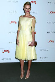 Kate Bosworth was the picture of perfection at the LACMA Gala, accenting her pastel yellow frock with a satin rose gold clutch.