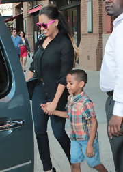 La La Anthony was casual yet smart in a black button-down and skinny jeans while out and about in New York.