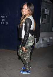 La La Anthony looked tough in her camouflage pants and leather jacket during a Knicks game.