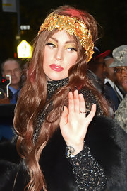Lady Gaga adorned her long hair with this gold headband.